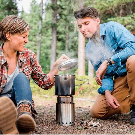 Couple Cooking On Camp Stove