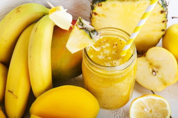 Smooties made out of pineapples, bananas and apples.